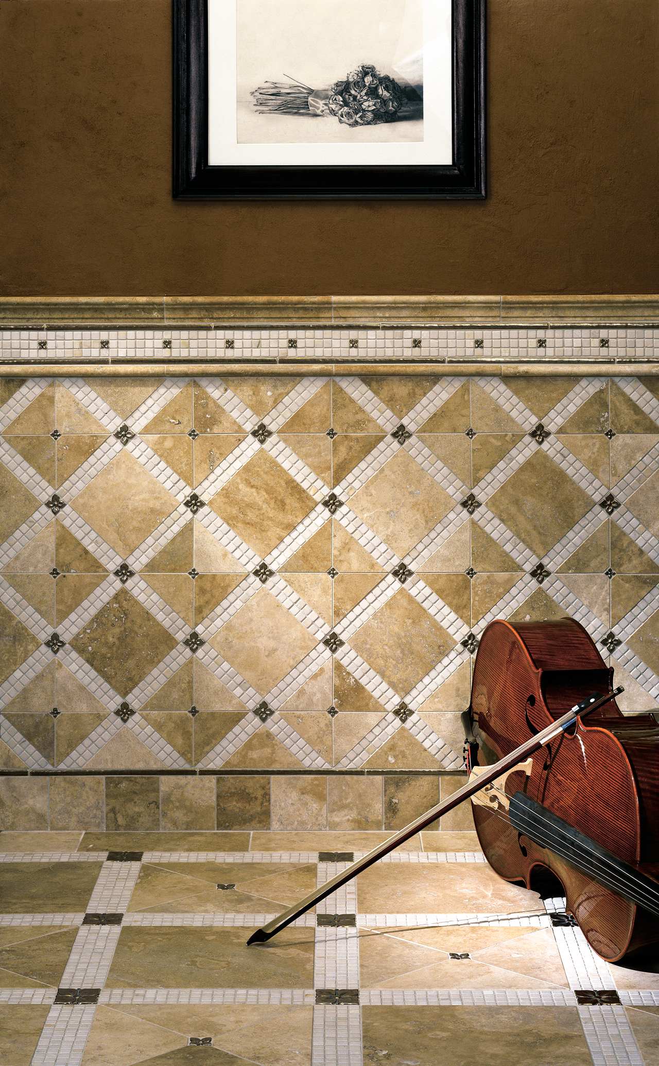 Metal accent tiles: Blooming Leaf in three sizes and Basic Liner in Traditional Bronze with beige limestone
