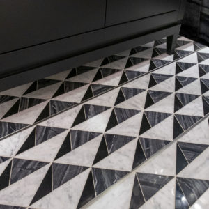 Bronzework Studio Precision Square Liner Stainless Steel metal accent black and white patterned stone floor
