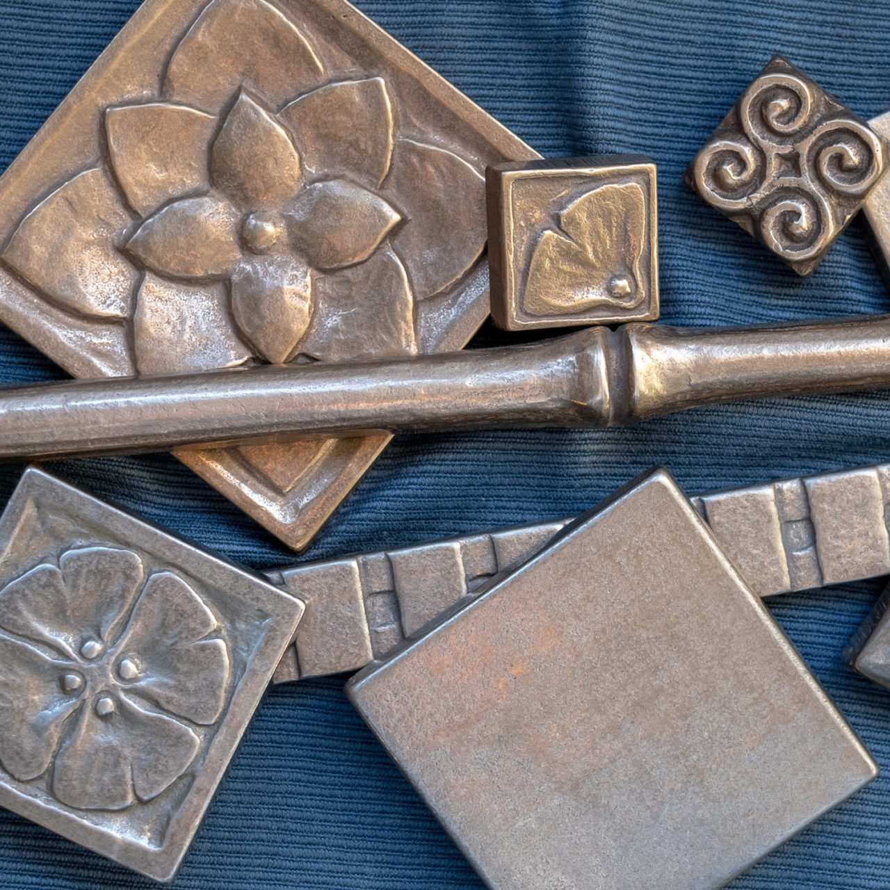 Foundry Art metal accent inset and liner tiles array