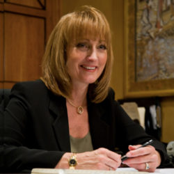 Gail Drury at desk