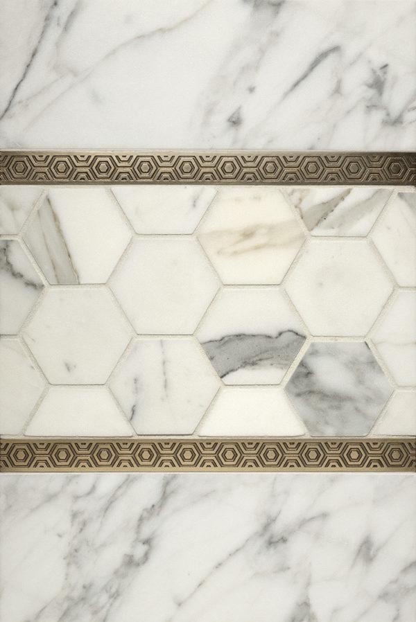 Crisp, graphic metal accent tiles in solid bronze