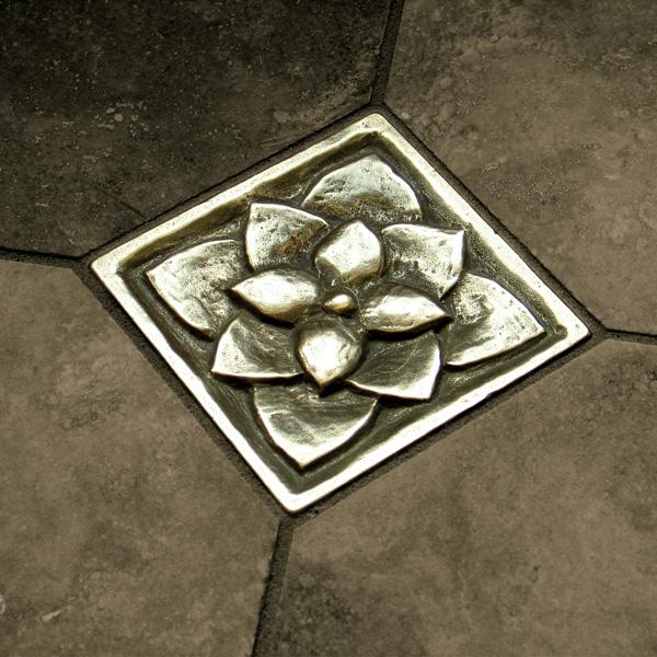 Foundry Art Lotus 3-inch metal accent inset tile dark gray limestone floor installation