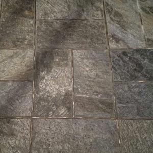 Bronzework Studio Classic Flowing metal accent liner tile slate floor
