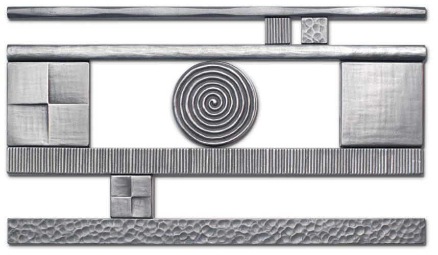 Metal tiles from Bronzework Studio. Hand-carved tiles cast in zinc.