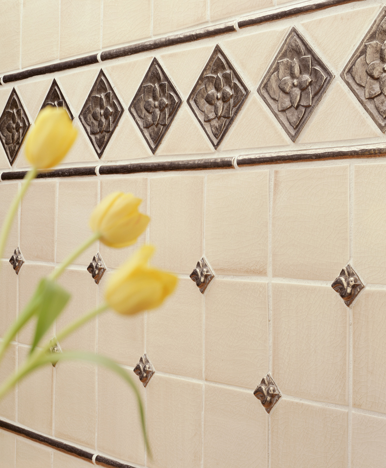 traditional bronze accent tile inset white ceramic wall Lotus
