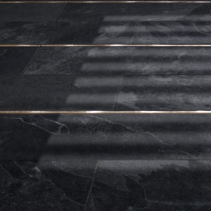 Bronzework Studio Classic Flowing metal accent liner tile with black stone