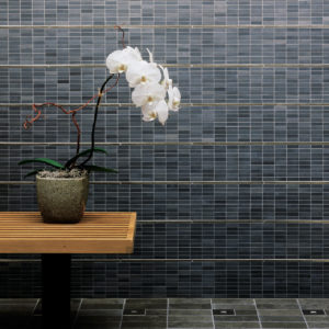 traditional bronze liner accent blue grey stone bathroom wall