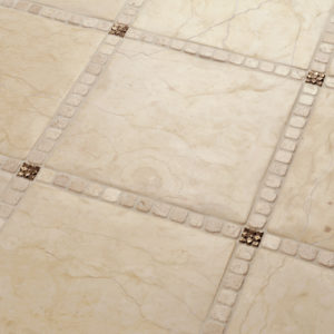 Foundry Art Lotus 1-inch metal accent inset tiles cream marble floor installation