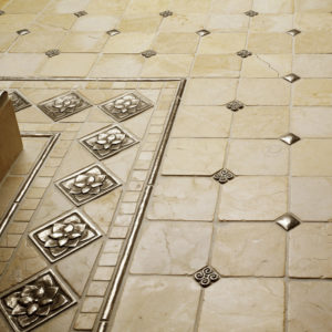 traditional bronze tile accent inset cream marble floor grid pattern Lotus