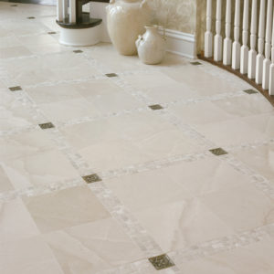 traditional bronze tile accent inset white marble floor foyer Lotus