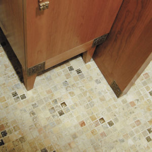 Foundry Art Lotus knob and various 1-inch metal accent inset tiles with stone mosaic floor