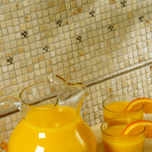 Bronzework Studio Classic Blooming Leaf .63-inch insets and Basic metal accent liner tiles limestone mosaic backsplash