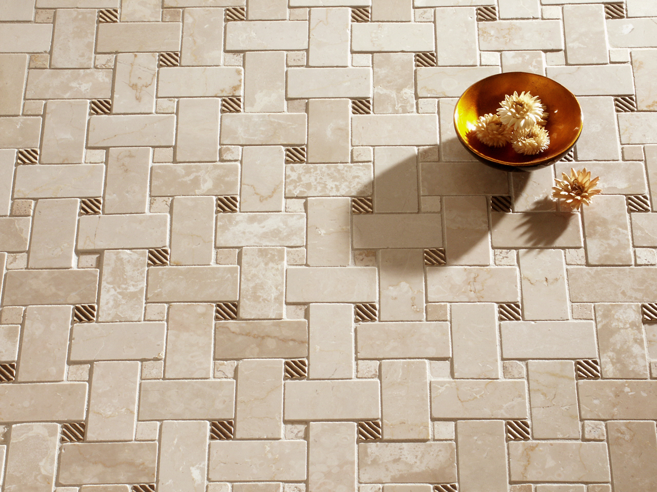 Metal accent tiles: Ruffle in Traditional Bronze with marble basketweave mosaic