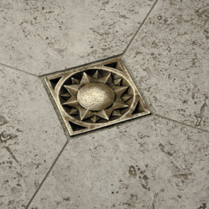 traditional bronze tile accent sun inlay grey limestone floor
