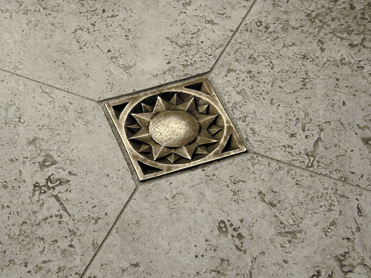 Sunrise 3x3 in Traditional Bronze with gray travertine limestone