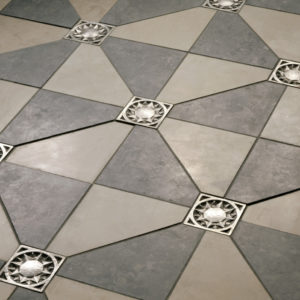 Foundry Art Sun metal accent inset tile light and dark gray limestone floor installation