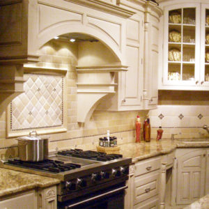 Traditional Bronze tile accent white French kitchen