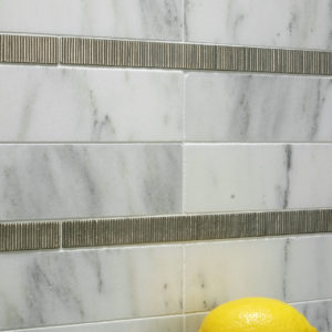white bronze liner accent tile marble wall Danby Vermont