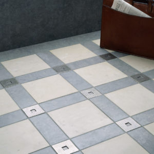 Foundry Art Square metal accent inset tile blue and gray limestone floor installation
