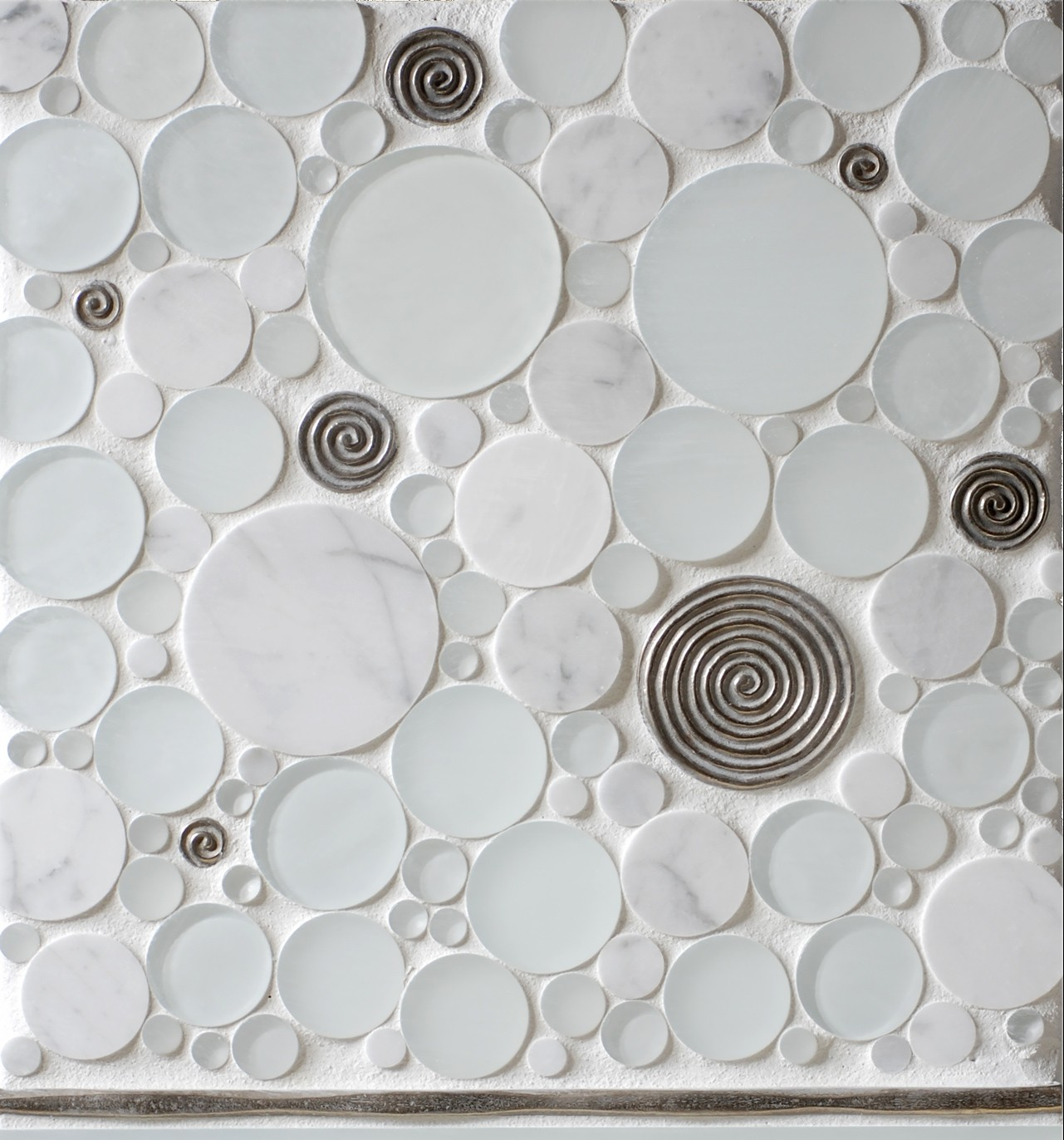 Metal accent tiles and liner: Petrogylph and Flowing Liner in White Bronze with marble and glass