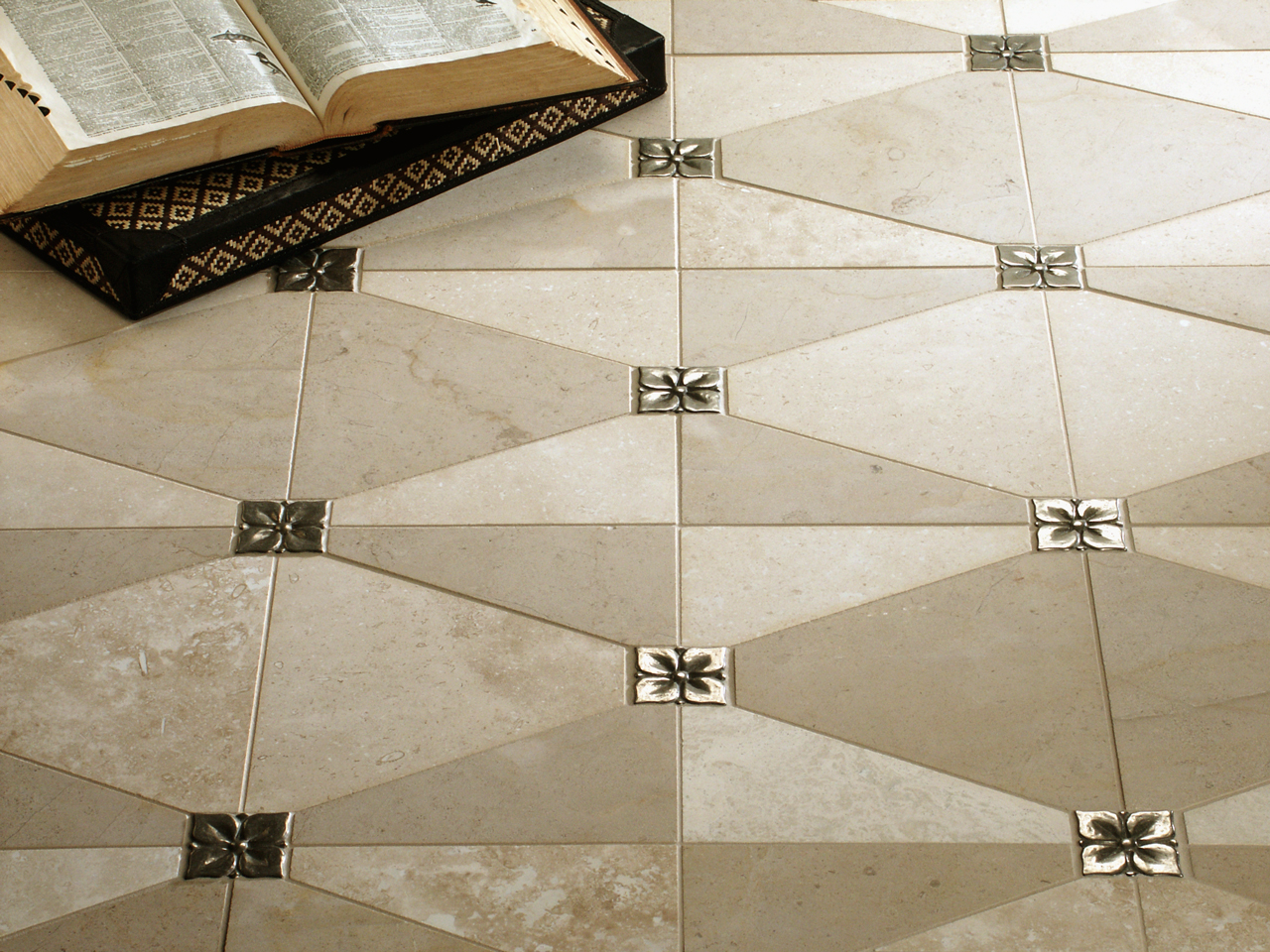 Metal accent tiles: Blooming Leaf in Traditional Bronze with cream limestone