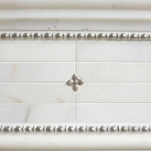 white bronze tile accent wainscot marble